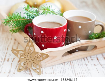 Cup of Christmas cappuccino on holiday background - stock photo