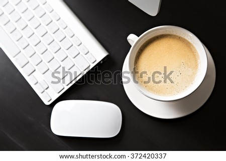 Cup of coffee and a computer at work . a coffee break - stock photo