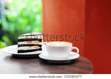 Cup of coffee and chocolate cake - stock photo