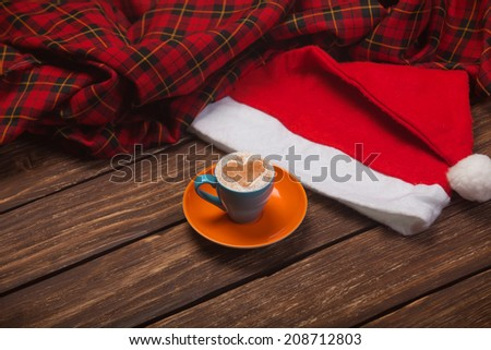 Cup of coffee and christmas hat - stock photo