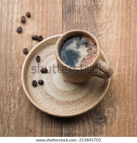 Cup of coffee and coffee beans, selective focus - stock photo