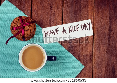 Cup of coffee and cookies on the table. Wishing a nice day. Pleasant surprise a friend or loved one. Note on the table next to the coffee and biscuits. - stock photo