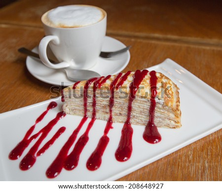 cup of coffee and delicious cake - stock photo