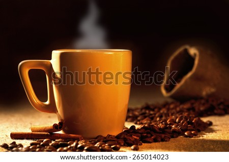 Cup of coffee and grains - stock photo
