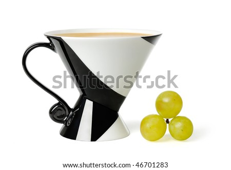 Cup of coffee and grapes - stock photo