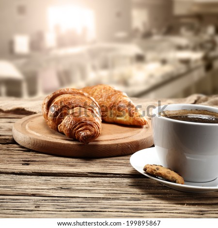 cup of coffee and interior of cafe  - stock photo