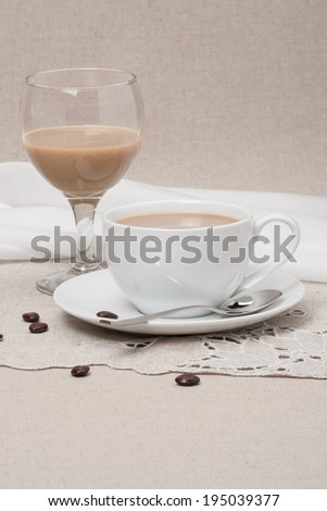 Cup Of Coffee and Irish Cream Liquor. Natural Linen Background. - stock photo