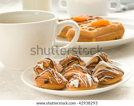 Cup of coffee and plate with cookies. Shallow dof. - stock photo