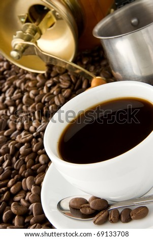 cup of coffee and pot, grinder on beans - stock photo