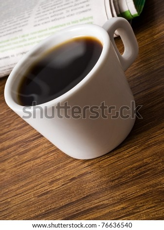 cup of coffee and stack of newspapers - stock photo