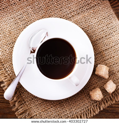 Cup of coffee and sugar top view. Coffee concept. Selective focus. - stock photo