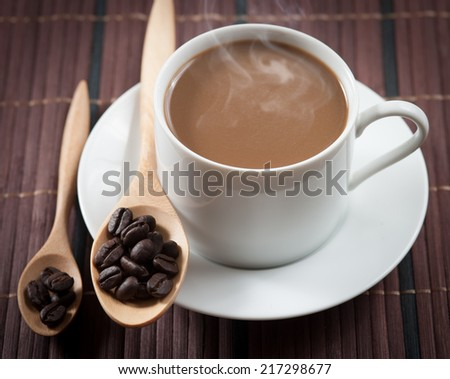 cup of coffee and Wooden Spoon on wood table - stock photo