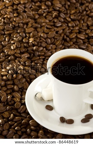 cup of coffee at roasted beans - stock photo