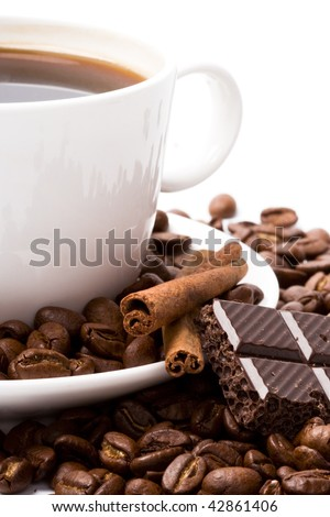 cup of coffee, beans, cinnamon and black chocolate closeup - stock photo