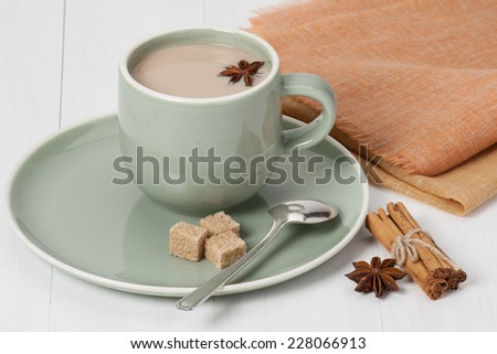Cup Of Coffee, Cocoa or Tea With Milk And Spices. Old Silver Spoon. - stock photo