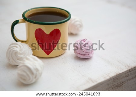 Cup Of Coffee. Coffee in cup with red heart and dessert - stock photo