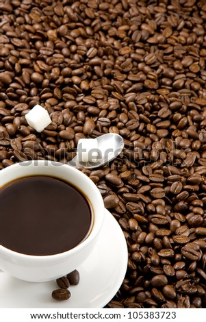 cup of coffee drink on beans background - stock photo