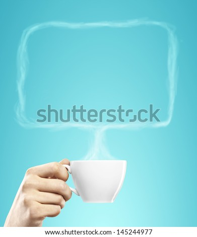 cup of coffee in hand with bubble talk - stock photo
