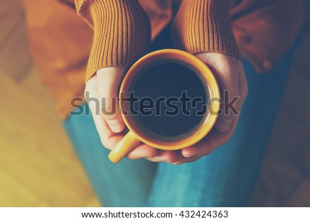 cup of coffee in hands - stock photo