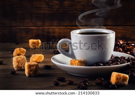 Cup of coffee in the old rustic style with cane sugar cubes and coffee beans. Coffee espresso.  - stock photo