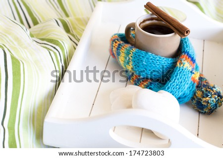 Cup of coffee in the wooden try on the bed - stock photo