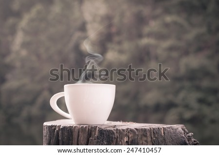 Cup of coffee in vintage style. - stock photo