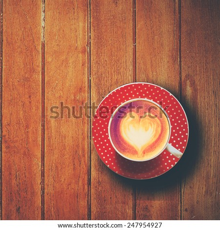 cup of coffee latte art on the wooden desk - stock photo