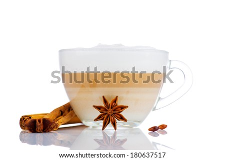 Cup of coffee latte with cinnamon sticks and star anise - stock photo