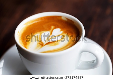 Cup of coffee. Morning atmospheric lighting, fashionable trendy spot soft focus. Preparation for design creative menu. - stock photo