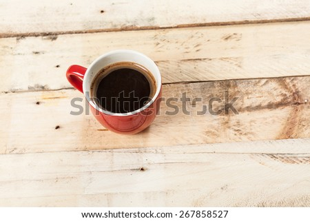 Cup of coffee on a wooden background. - stock photo