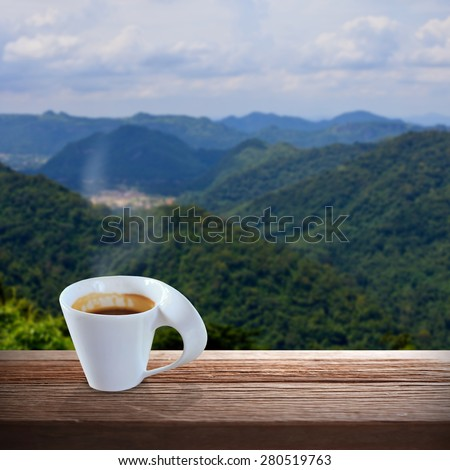 Cup of coffee on a wooden table - stock photo