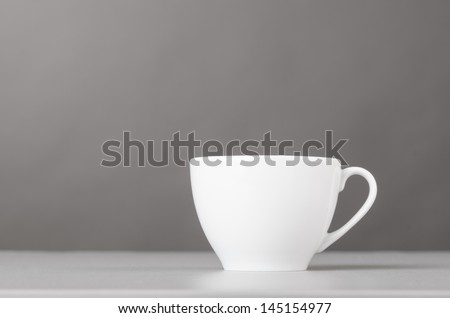 cup of coffee on gray background - stock photo