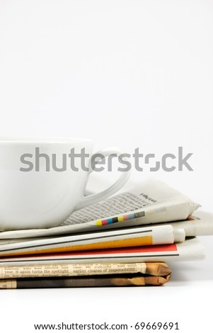 Cup of coffee on newspaper - stock photo