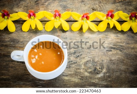 cup of coffee on old wood background - stock photo