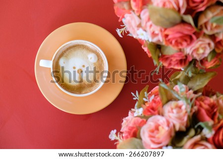 cup of coffee on red table in cafe - stock photo
