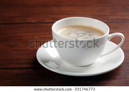 Cup of coffee on table close up - stock photo