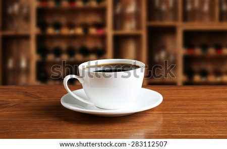Cup of coffee on table in coffee shop - stock photo