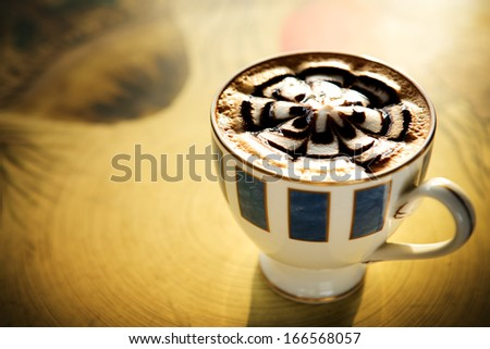 Cup of coffee on table in the morning - stock photo