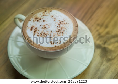 Cup of coffee on table with chair in coffee shop , Vintage color  - stock photo