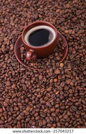 Cup of coffee on the coffee beans background - stock photo