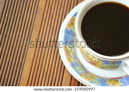 cup of coffee on the table with empty space - stock photo