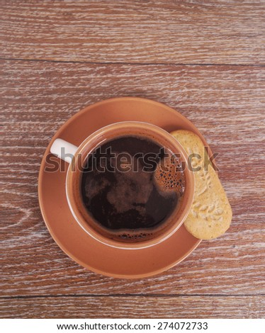 Cup of coffee on the wooden table - stock photo