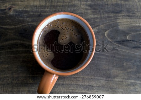 cup of coffee on the wooden table, from above - stock photo