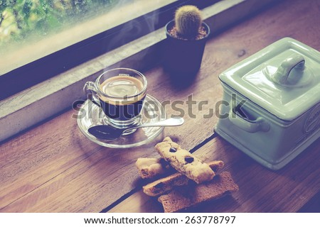 cup of coffee on wood table in cafe. vintage effect. - stock photo