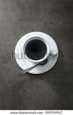 Cup of coffee on wooden  dark table, from above - stock photo