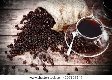cup of coffee on wooden table - stock photo