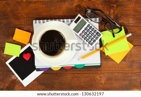 Cup of coffee on worktable close up - stock photo