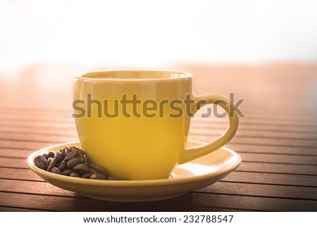 Cup of coffee over wooden table - stock photo