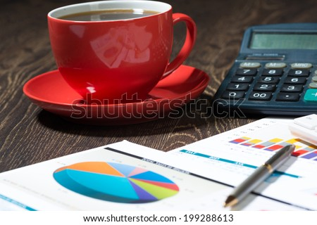 cup of coffee, phone, business papers and keyboard. Workplace of the businessman. - stock photo