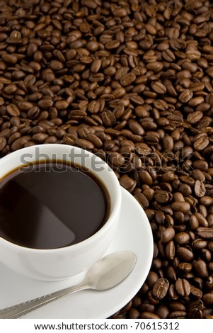 cup of coffee, spoon and beans - stock photo